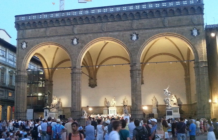 Loggia Lanzi at twilight in Piazza Signoria with live music.
