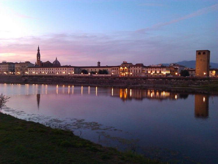 The Arno River at night with the Florence skyline