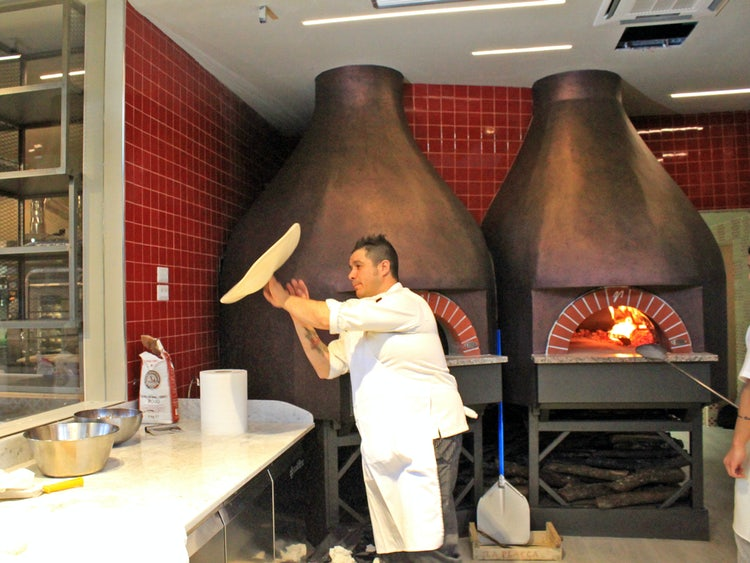 making pizza at mercato centrale