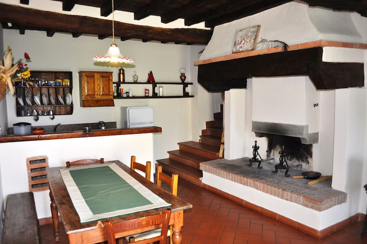 Kitchen with fireplace at I Nidi di Belforte