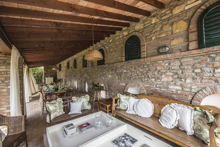 Relax in the shadey loggia at the holiday vacation rental Villa Piaggia near Montaione